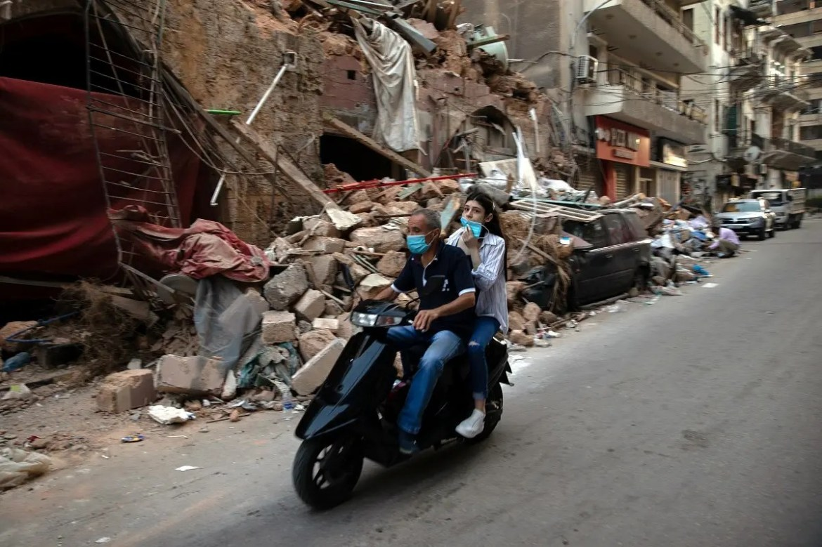 People on a scooter drive by damaged traditional Lebanese house, following a massive explosion at the port area, in Beirut. (Reuters)