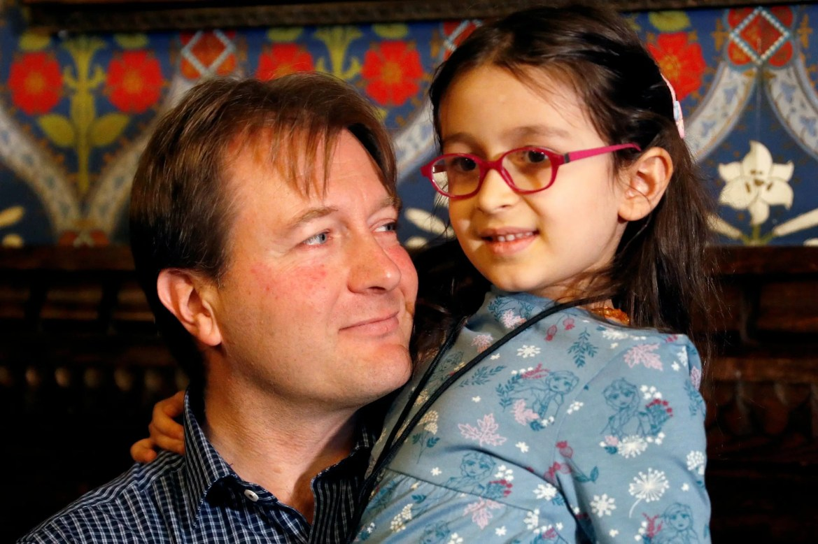 Richard Ratcliffe, the husband of jailed British-Iranian aid worker Nazanin Zaghari-Ratcliffe, sits with his daughter Gabriella during a news conference in London, Britain October 11, 2019. (Reuters)