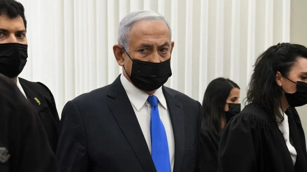 Israeli PM Netanyahu stands inside the courtroom just before the start of a hearing in his corruption trial at Jerusalem's District Court February 8, 2021. (Reuben Castro/Pool via Reuters)