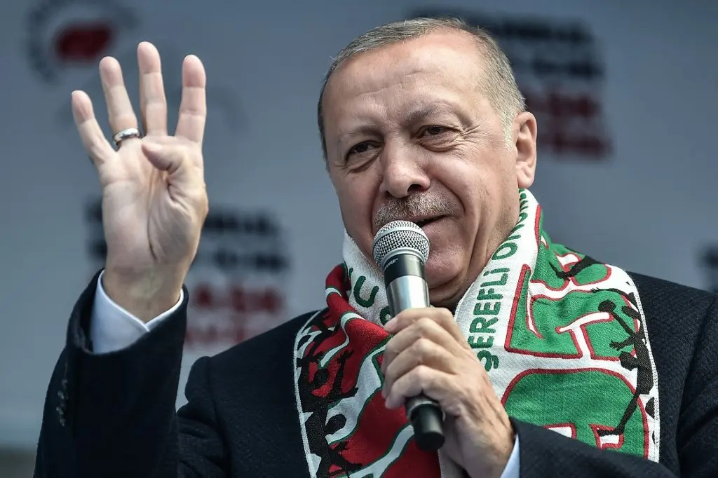 Turkish President Recep Tayyip Erdogan flashes four fingers and makes the Rabia sign as he speaks during a pre-election rally at Bayrampasa district in Istanbul, on March 30, 2019. (AFP)