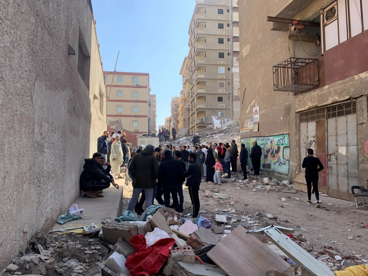 People inspect the area where a building was collapsed in Gesr al-Suez, Cairo. (Reuters)
