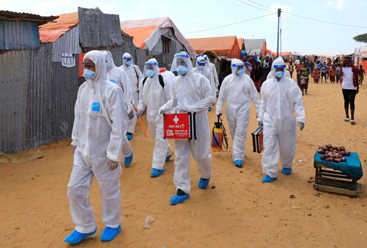 Members of Somali First Aid Association (SOFA) arrive to spray disinfectants in an effort to stop the spread of the coronavirus disease (COVID-19) at a camp for the internally displaced people in Mogadishu, Somalia April 18, 2021. (Reuters)