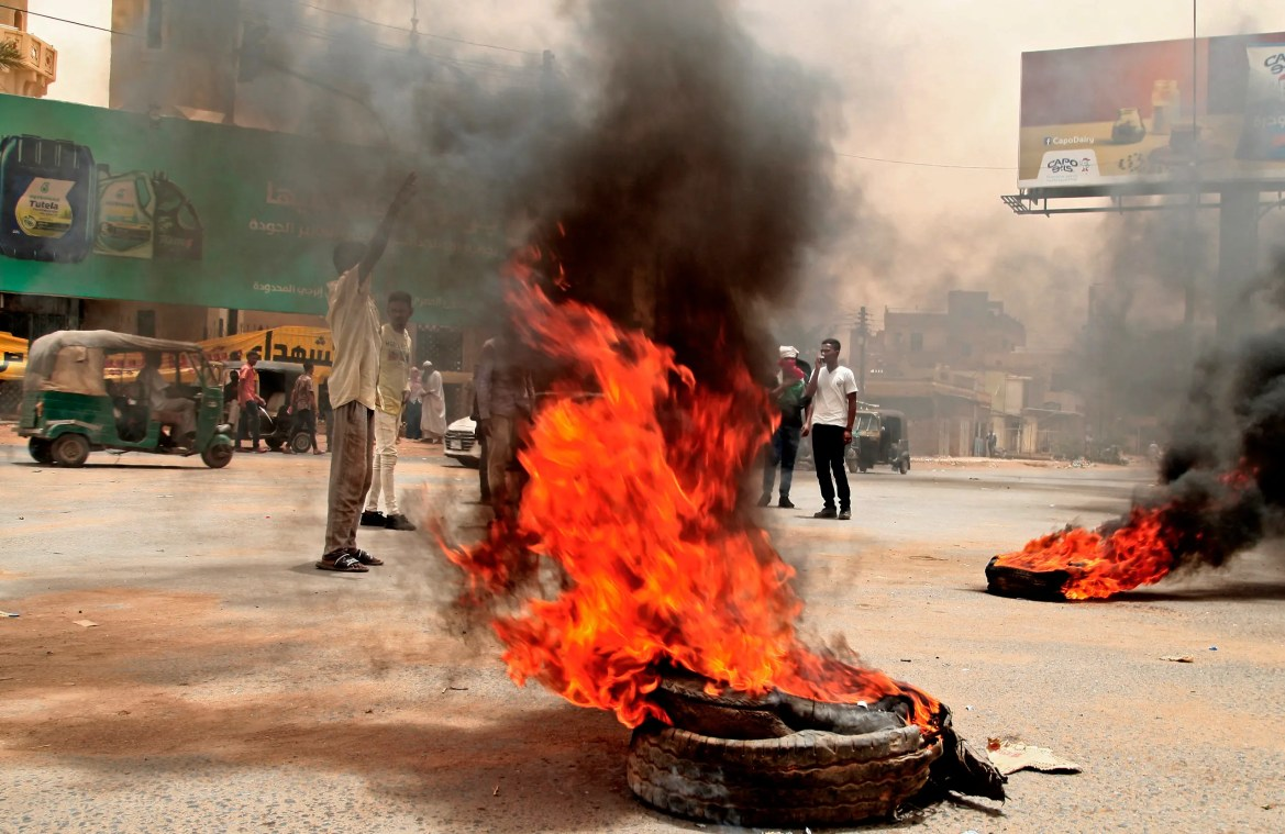 Sudanese protesters burn tires during a demonstration in Omdurman, the capital's twin city, urging the government to step down over delayed justice and recent harsh economic reforms, on June 30, 2021. (AFP)