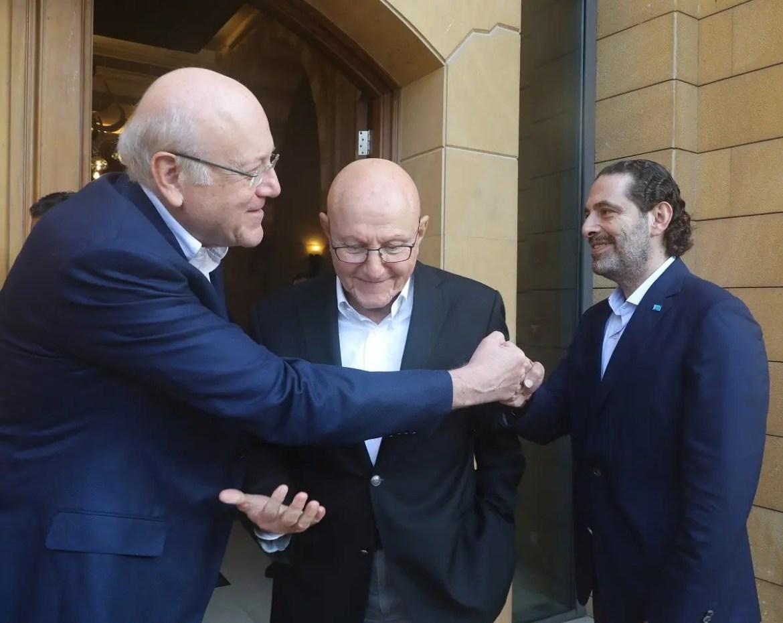 Former Lebanese PM Saad Hariri and PM-designate Najib Mikati greet each other in Beirut, July 25, 2021. (Reuters)
