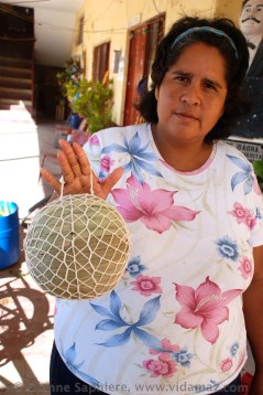 This lady makes barcinas of dried shrimp