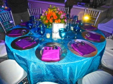 I absolutely loved the table colors! And the flowers were to die for.