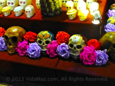 Closeup of some of the painted ceramic skulls, below, and sugar skulls, above