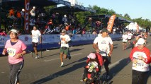 A competitor on crutches (one leg) and another with a stroller