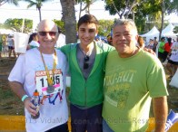 The champion with his son and compadre, Jorge