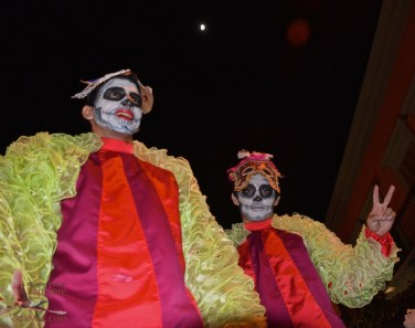 The moon over the stilt-walkers
