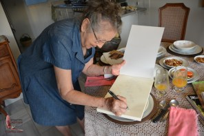 Doña Cuca signing the book for me