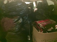 A few of the dozens of bagfuls of clothing, shoes, and linens we've received