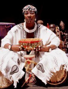 Megashia Jackson performs African drumming.