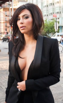 Kim Kardashian Black coat and boobs