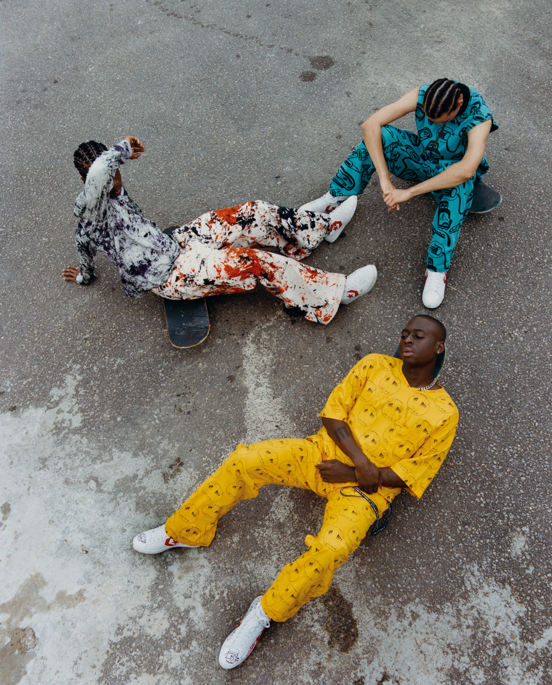 Three men on skateboards, photographed from above