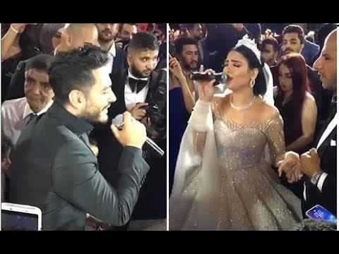 عروس تفاجئ المعازيم بصوتها في أغنية مشتركة مع تامر حسني