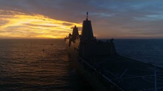 NASA's Test Orion Spacecraft in the Pacific Ocean at Sunset