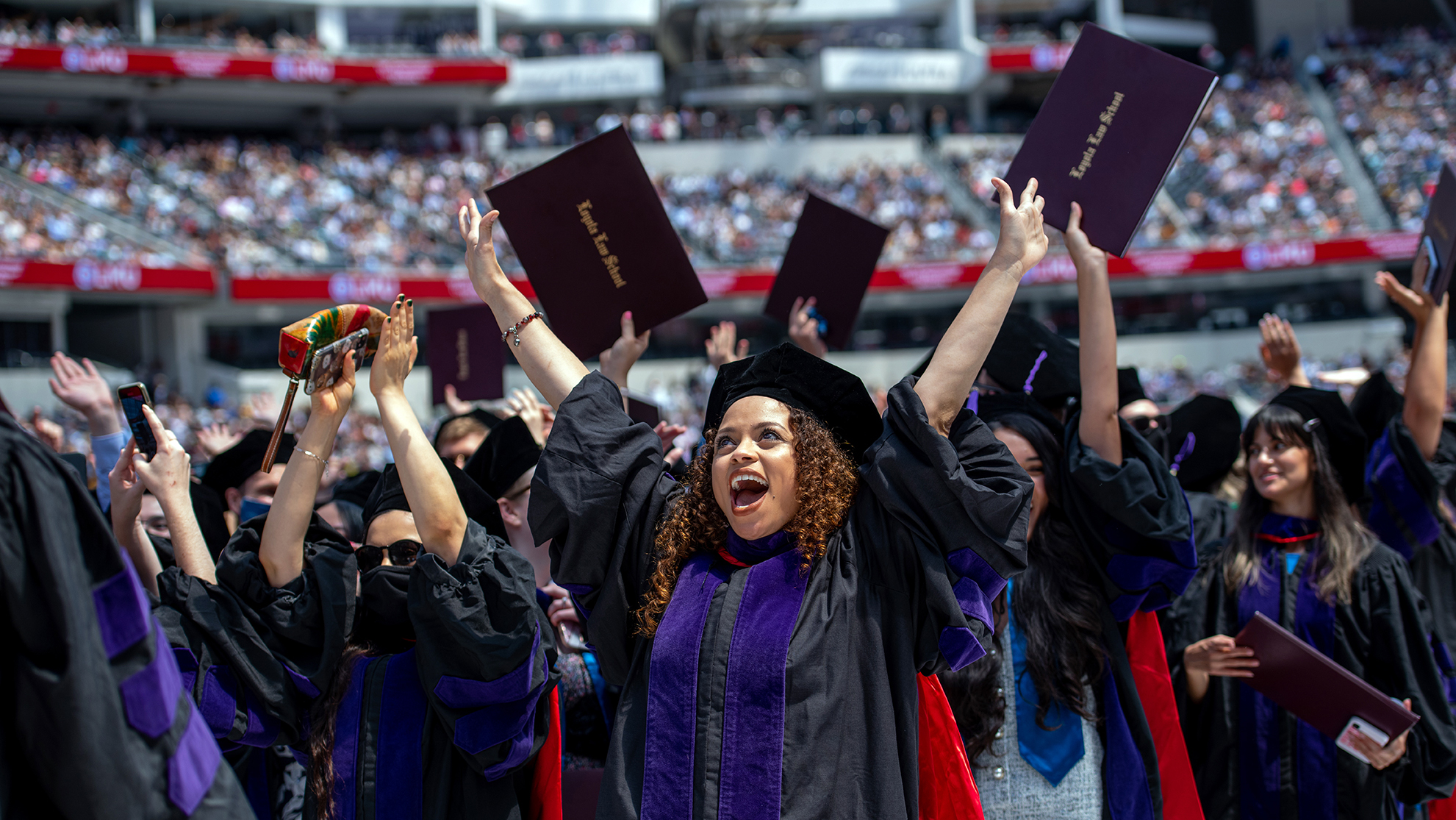Students celebrating in SoFi Stadium at the conclusion of the 108th Commencement Exercises