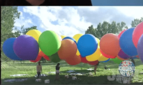 A Man Uses 110 Over Sized Balloons to Fly In A Lawn Chair