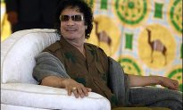 Qaddafi's Hoards of Cash Fund Human Rights Abuse
