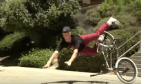 BMX Rider Doesn't Give Up Until He Lands His Trick Down Massive Stair Case