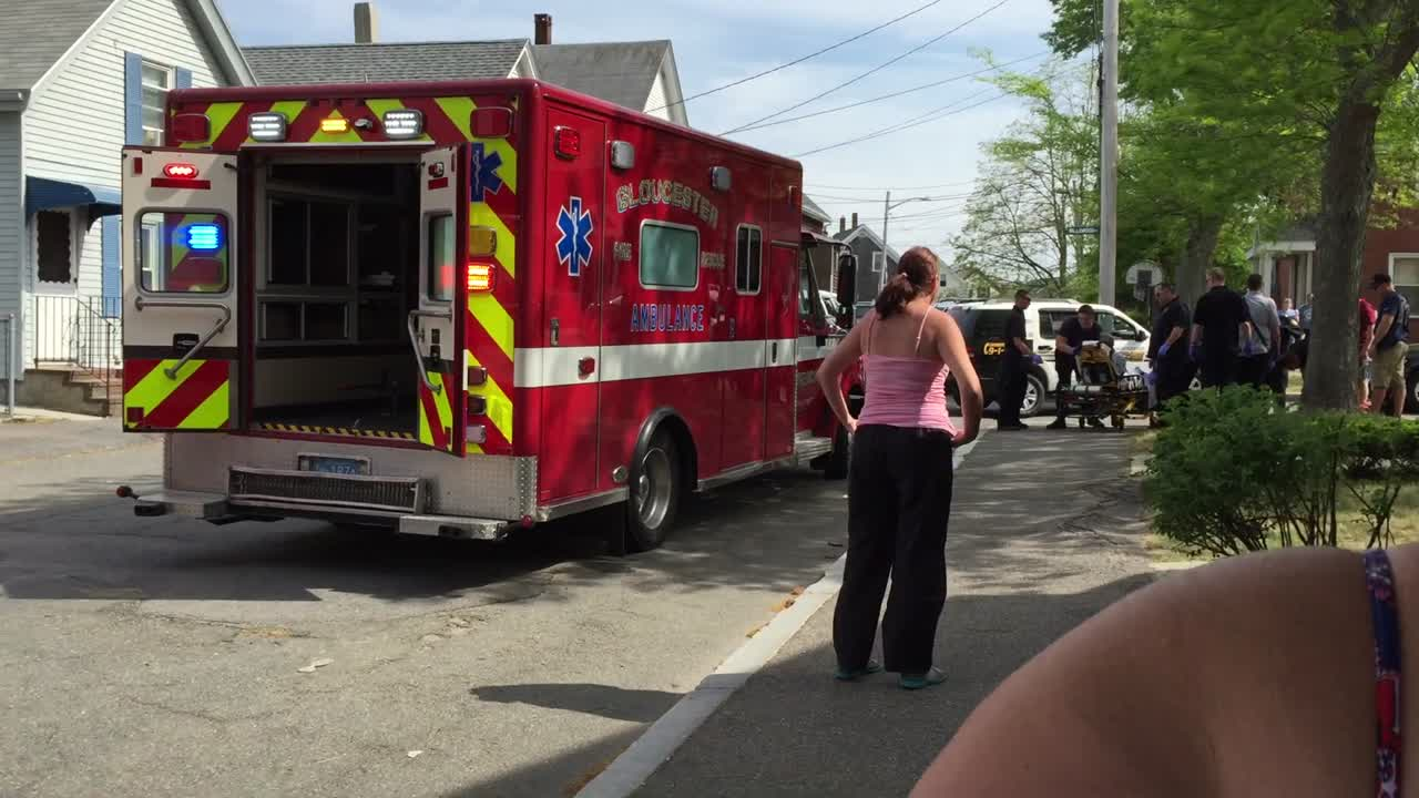 Foot chase suspect is loaded into ambulance.
