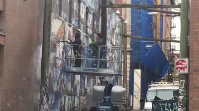 Vancouver Jump for JOy Photo Mural Removal