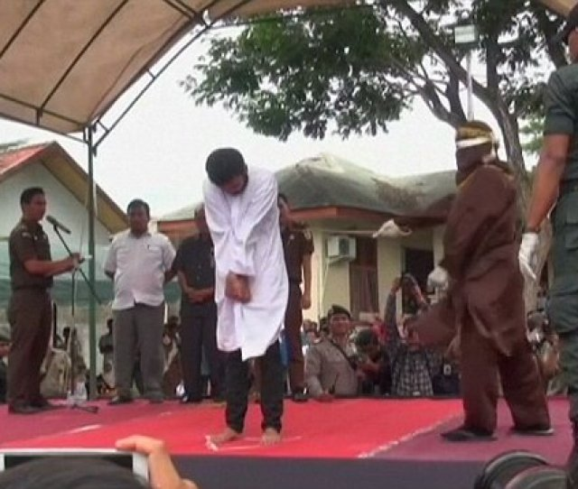 Indonesian Men Publicly Caned For Having Gay Sexhttps Metro Co Uk Video Indonesian Men Publicly Caned Having Gay Sex