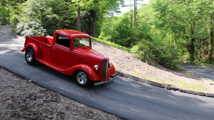 Donna Hotchkiss of Thomaston, Conn. owns a hot-rodded, bright red 1935 Ford pickup truck that was willed to her by an uncle two years ago. She uses it for cruising and for going to car shows.