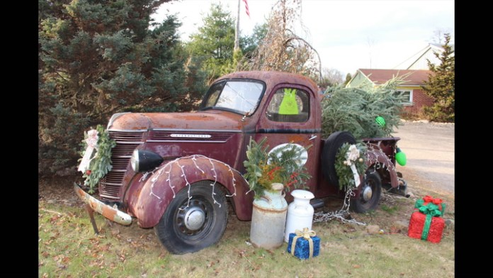 Richard H. Lewis III, owner of Woodbridge Estate Care in Bethany, Conn., is caretaker of a rusting, non-running 1938 International Harvester pickup that he uses as a planter at his business on busy Route 63.