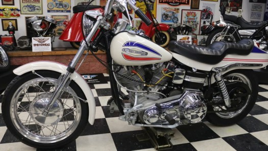 """""""Doc"""" D'Occhio, founder of Doc's Motorcycle Parts in Waterbury, CT, has just restored an uncommon 1971 Harley-Davidson FX Super Glide. It's a model that stands out because of its boat-tail rear end and oddly-mounted shifter. RIDE-CT has details."""