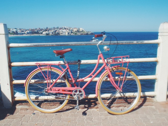 A girl can dream... I'd love a bike like this, tied to the rails at Bondi Beach.