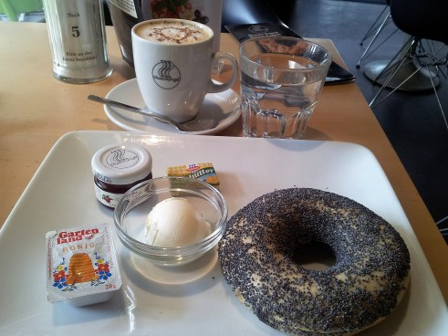 Hot Poppy Seed Bagel & Sour Cream Breakfast with Marmalade, Honey and Coffee