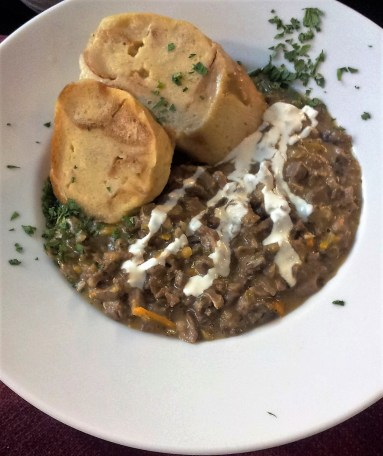 The Kalbsrahmbeuschel (creamed chopped calf's light's) with cream and bread dumplings
