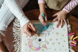 crop kid with mother coloring picture of unicorn