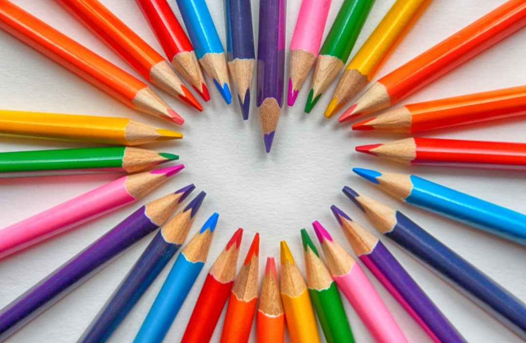set of coloring pencils forming heart