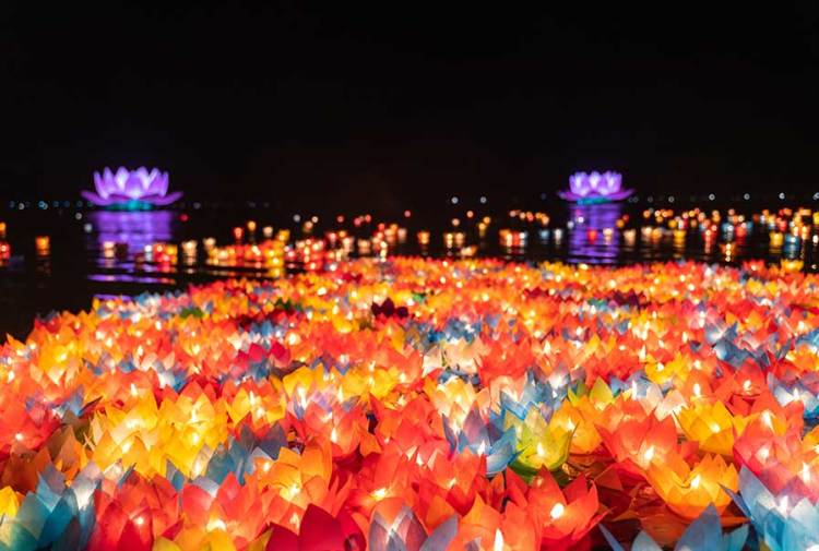 Floating colored lanterns and garlands on river