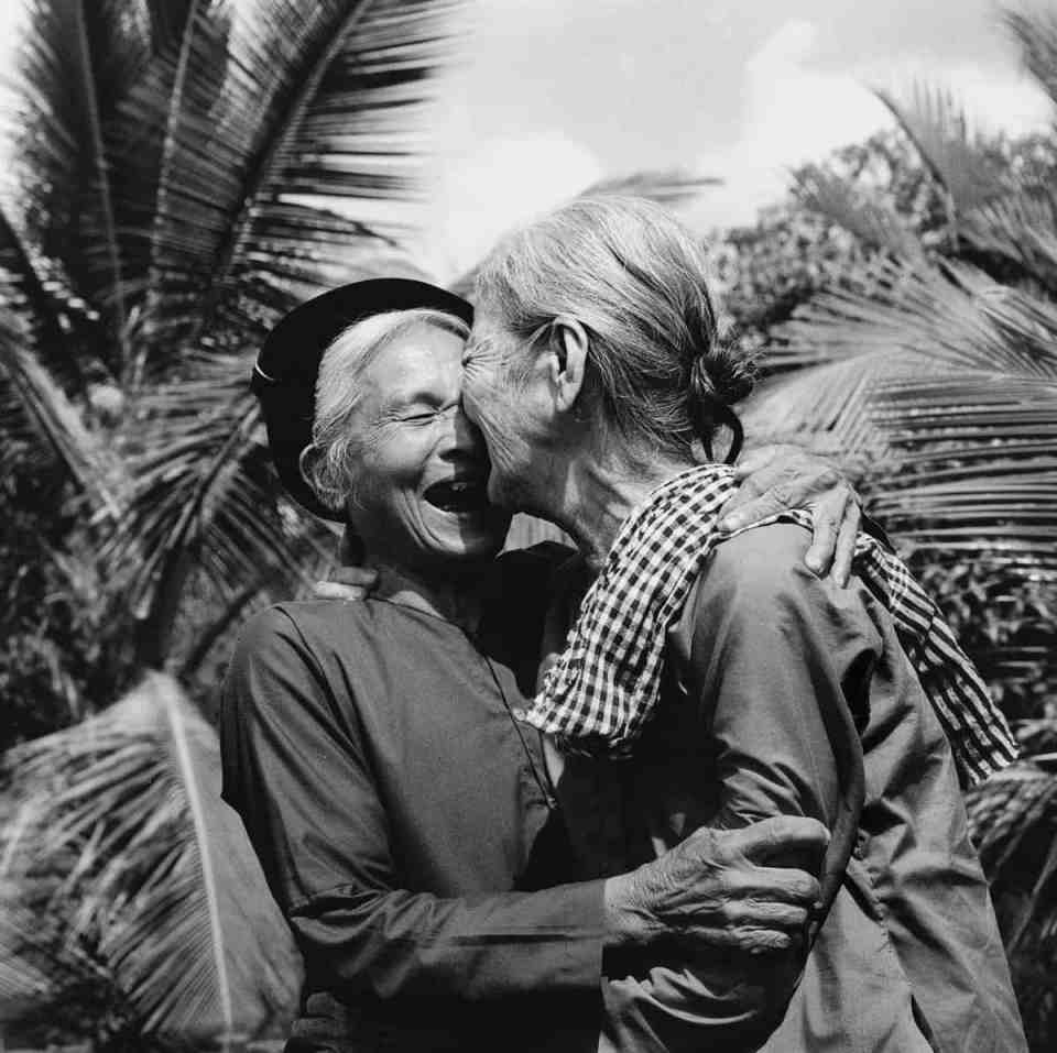 May 1975 Elders from North and South embrace, having lived to see Vietnam reunited and unoccupied by foreign powers. IMAGE: VO ANH KHANH/ANOTHER VIETNAM/NATIONAL GEOGRAPHIC BOOKS