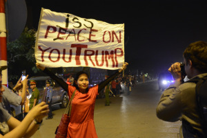 Mai Khoi holding banner reading Peaceiss on you Trump in Hanoi - Vietnam Free Expression Newsletter No. 37-2017 – Week of November 6-12