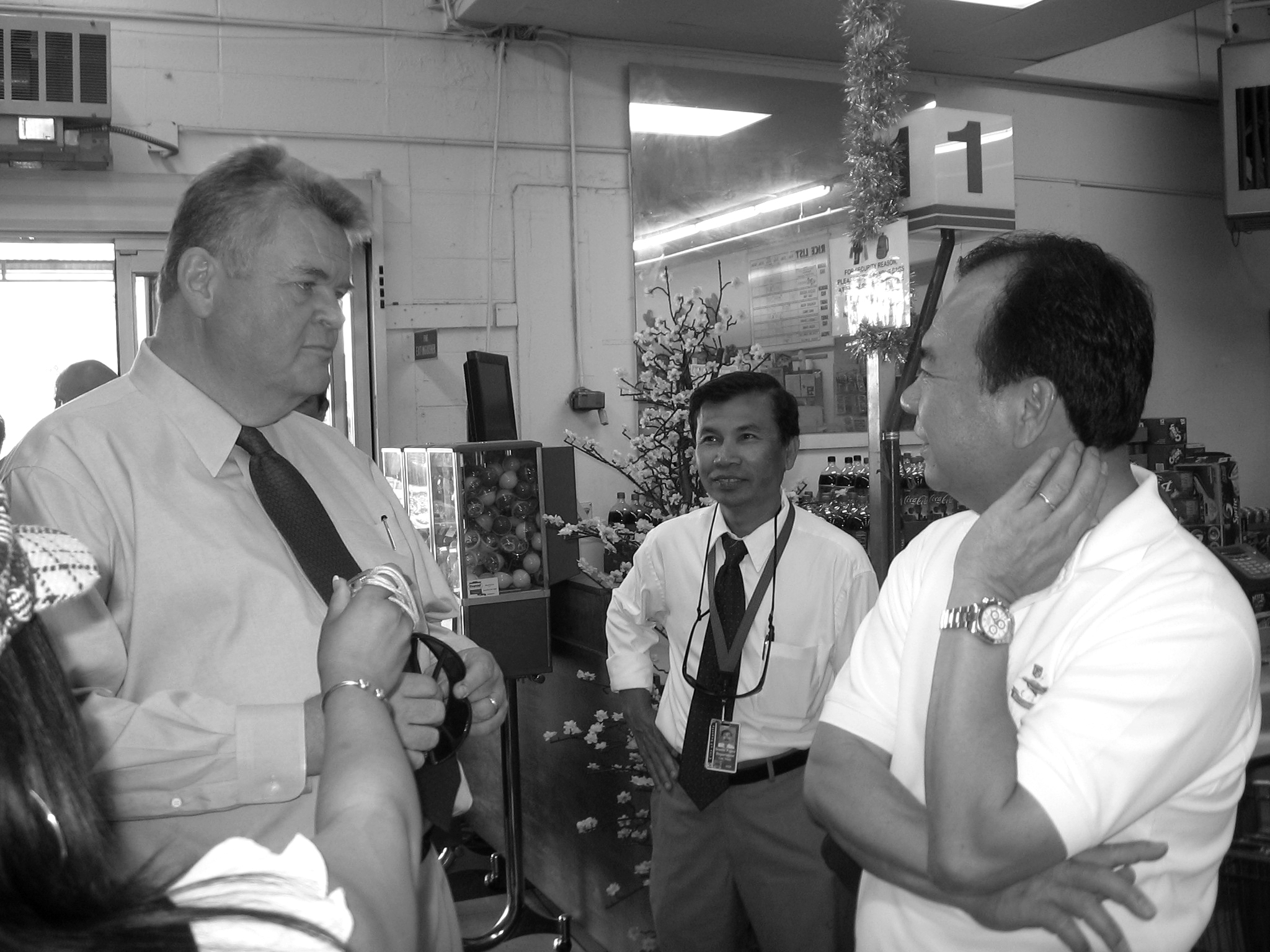 Mayor Greg Nickels, left, meets with Viet Wah grocery store owner Duc Tran, right. -- International Examiner Photo, August 8 & September 2, 2008