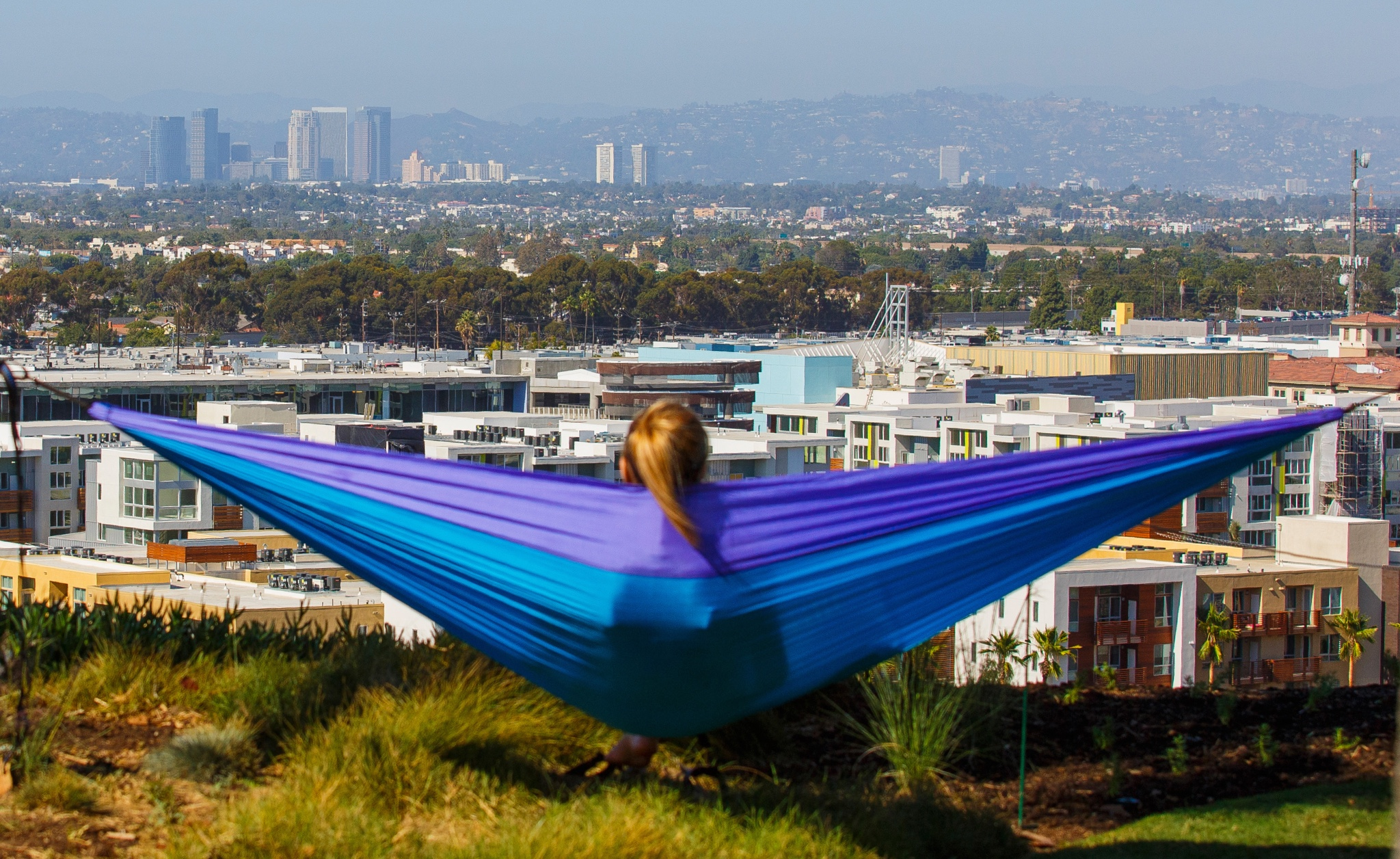 LMU student in a hammock look out over the bluff.