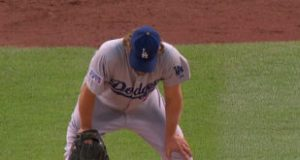Clayton Kershaw has hands on knees after being owned by the Cardinals.