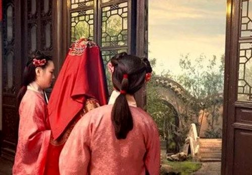 The girl had her head covered with a red silk cloth