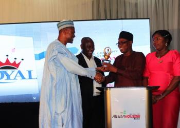 West African Ceramics Ltd (2nd right) receives award from Umar Shuaibu