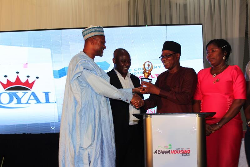 West African Ceramics Ltd (2nd right) receives award from Umar Shuaibu