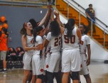 The women's basketball team cheer in a huddle after their victory over visiting team Irvine Valley College on Feb. 17, 2016 where they finished 57-56.