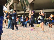 "Students dance to the ""Cha Cha Slide"" to get warmed up for the Amazing College Race in Downtown Riverside April 10. (Crystal Olmedo 