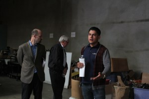 Jesse Guzman, Digital Inclusion program manager of SmartRiverside, leads a tour through their facility to display what employees and volunteers alike create in the everyday workspace on Nov. 20. The Bridge project upcycles used computers and provides them to low income families.