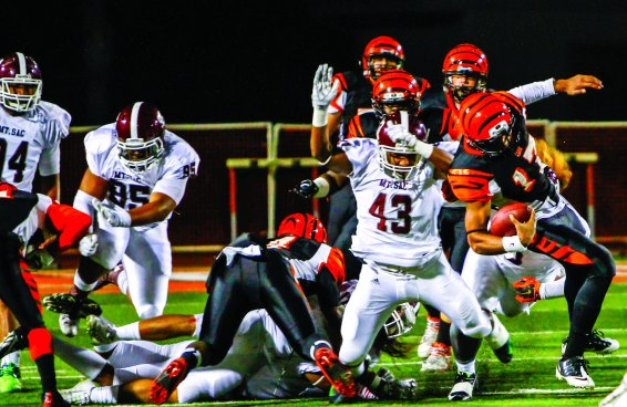 POUNCE: Sitiveni Tamaivena and the Mt. SAC defense capitalized on the miscues within the RCC offense. (Luis Solis | Photo Editor)