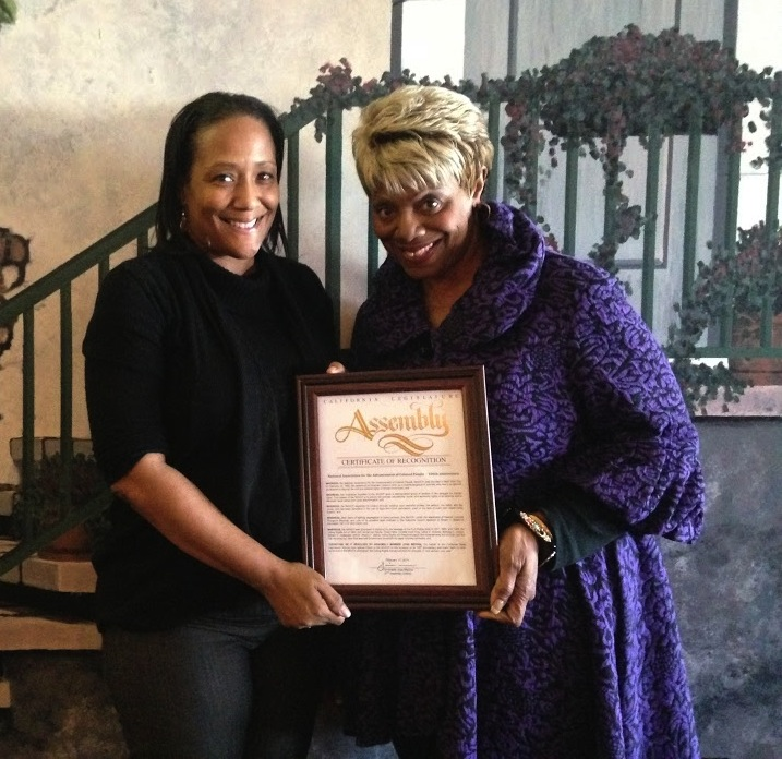 Natasha Ferguson (left), Executive Commitee Member of NAACP, and Regina Patton-Stell (right) , Vice President of NAACP Riverside, pose with the Proclamation of the 106th anniversary. Brooke Cary | Viewpoints